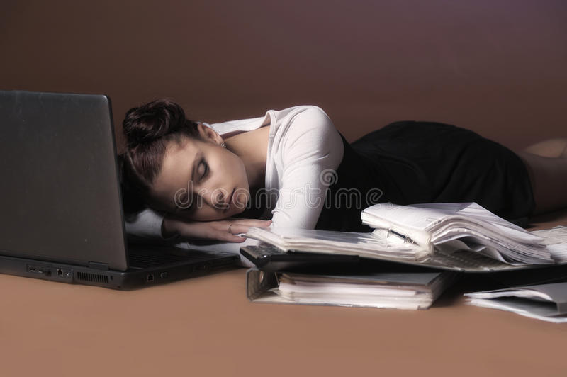 Business woman sleeping in front of laptop royalty free stock photo