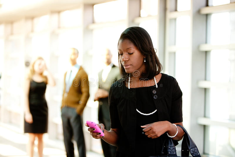 Business Woman with Smart Phone royalty free stock photography