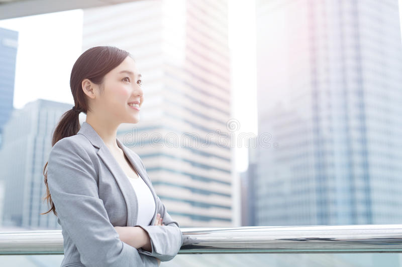 Business woman smile and look. With office background, asian beauty, shot in Hong Kong stock image