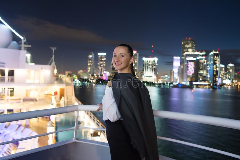 Business woman smile on ship board at night in miami, usa. Sensual woman in suit jacket on city skyline. Fashion, beauty, look. Tr royalty free stock photos