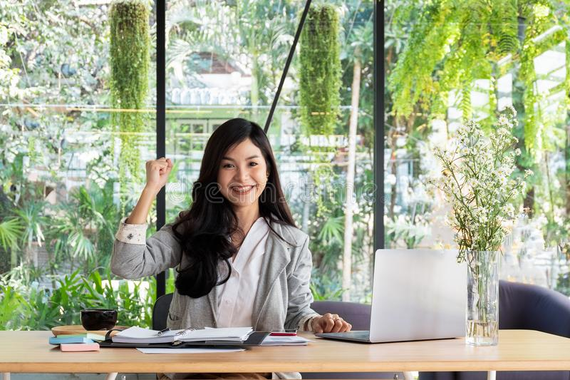 Business woman smiling with arms up celebrating for success work stock photos