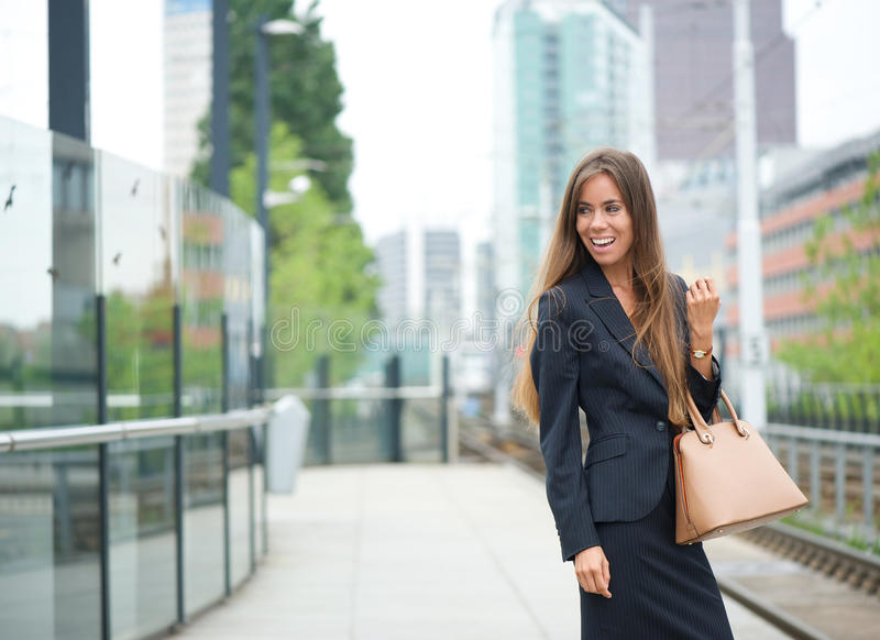Business woman smiling at outdoor train station stock images