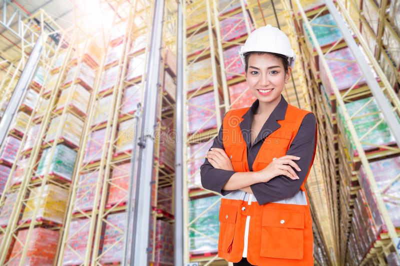Business woman smiling in warehouse stock photos