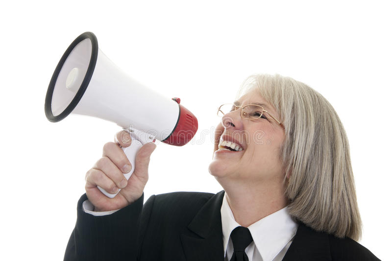 Business woman speaking into a bullhorn. Smiling Caucasian business woman speaking into a bullhorn stock photo