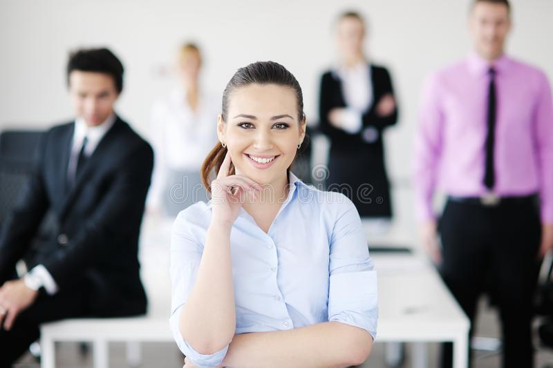 Business woman standing in front of with her staff royalty free stock photo