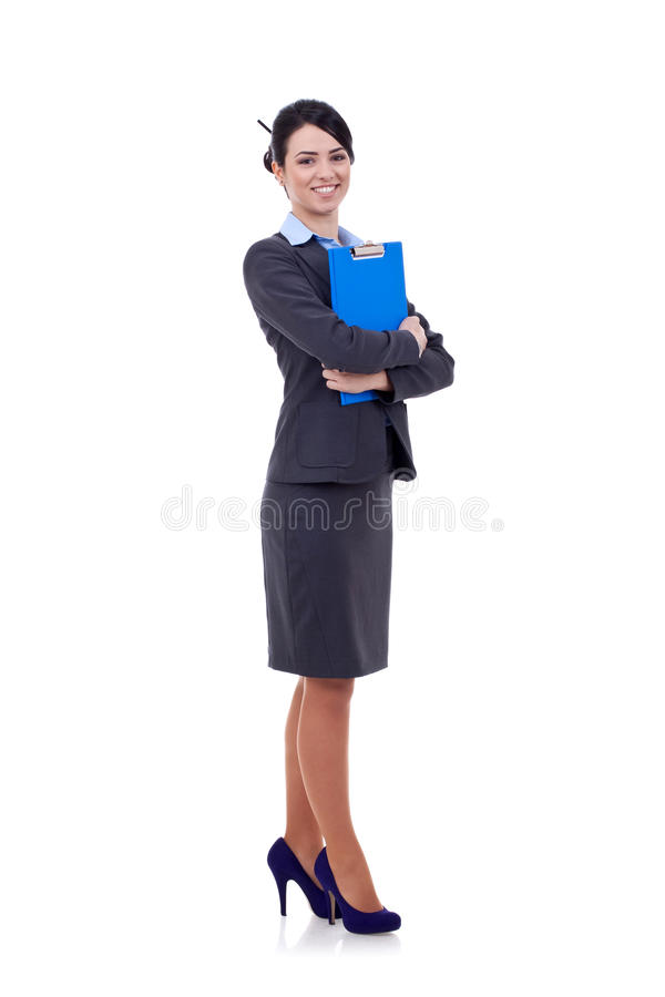 Business woman standing with her clipboard royalty free stock image