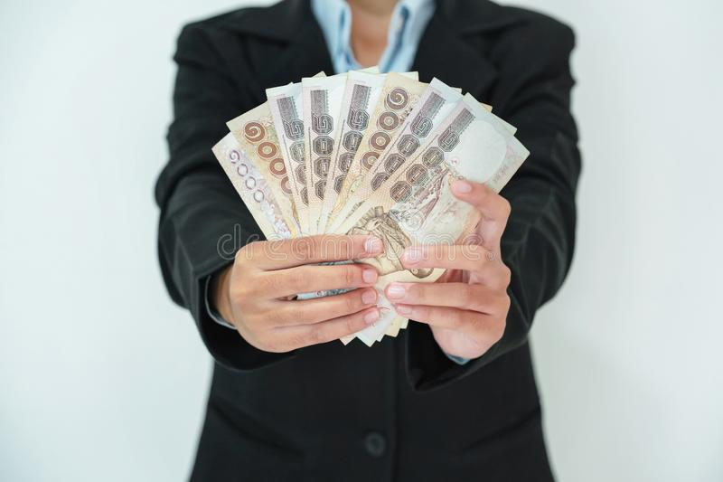 business woman standing holding money isolate on white background stock photography