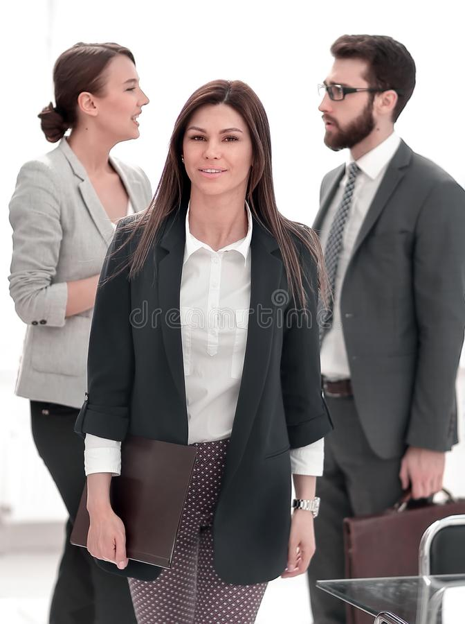 Business woman standing near the Desk stock images
