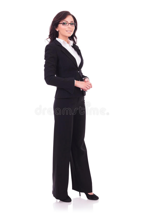 Business woman stands & smiles stock images