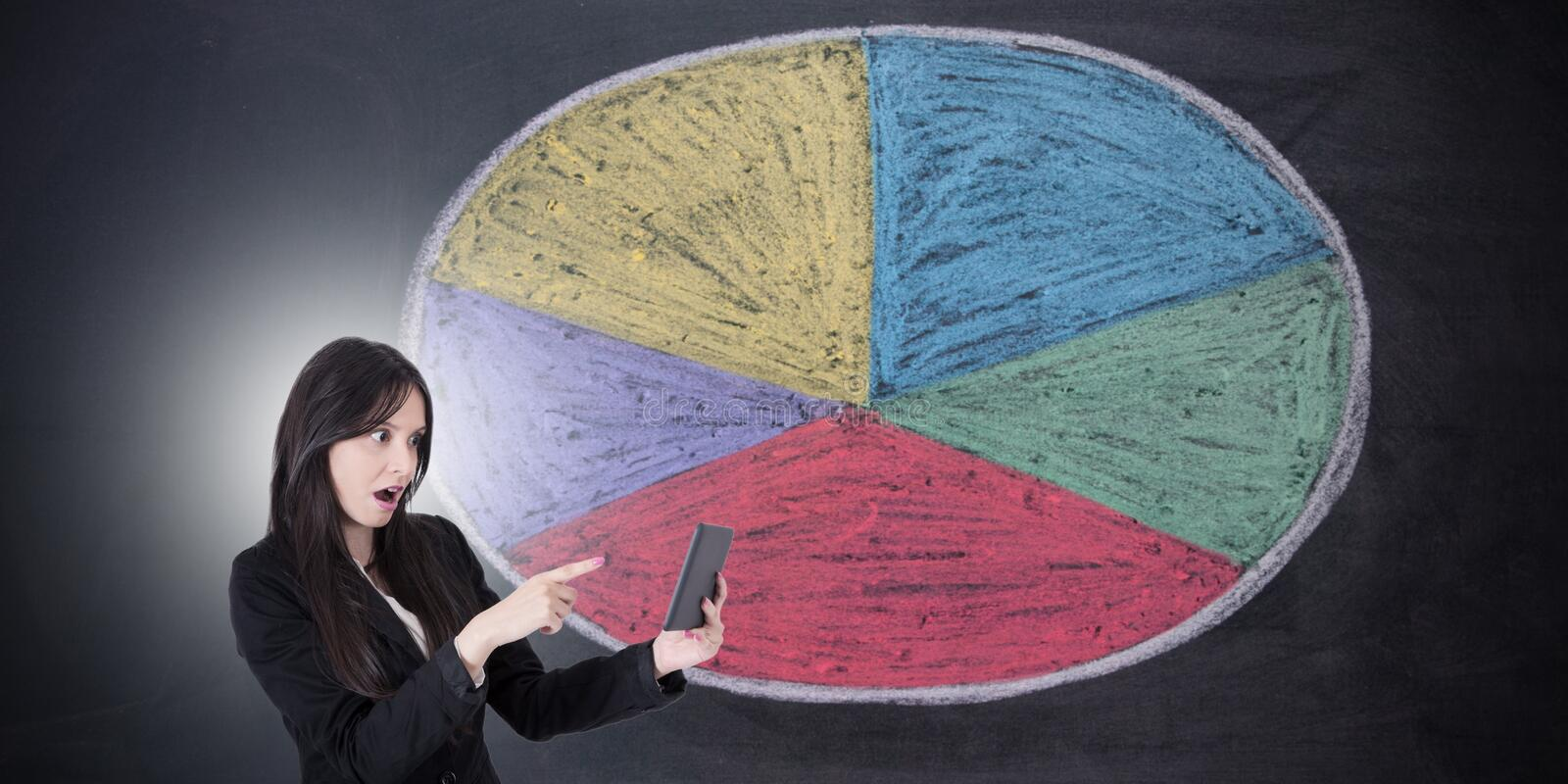 Business woman with statistics royalty free stock photos