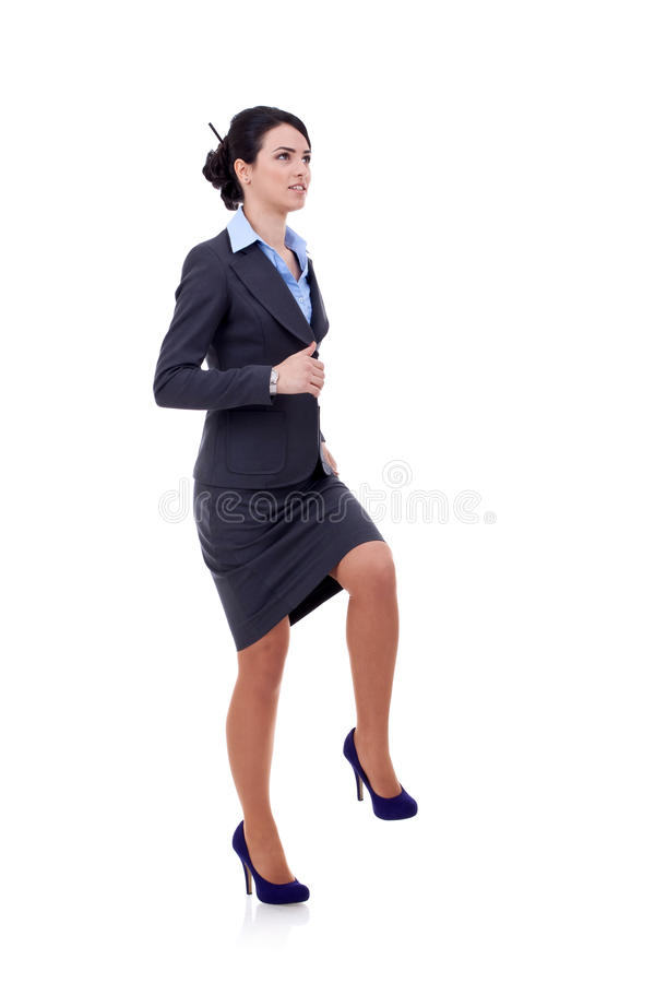 Business woman stepping on imaginary step stock photos