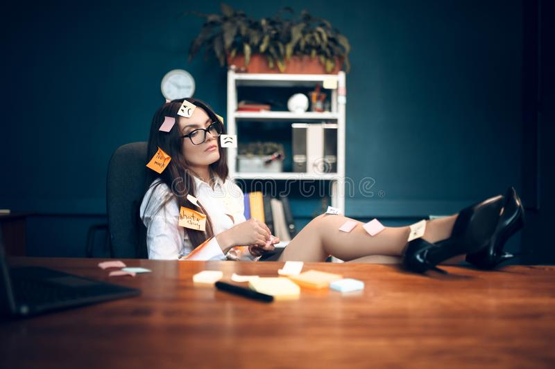 Business woman with sticky notes all over her. stock images