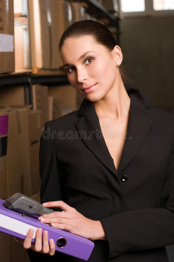 Business woman stock counting in warehouse stock photos