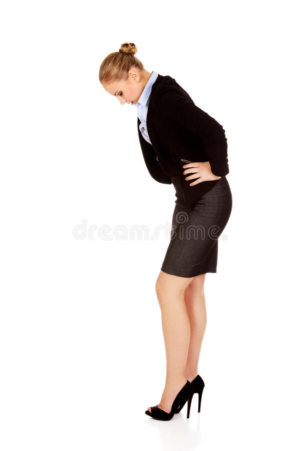Business woman with stomach ache.  royalty free stock photos
