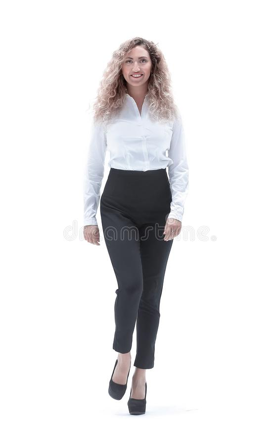 Business woman striding confidently forward. In full growth. a young business woman striding confidently forward stock photo