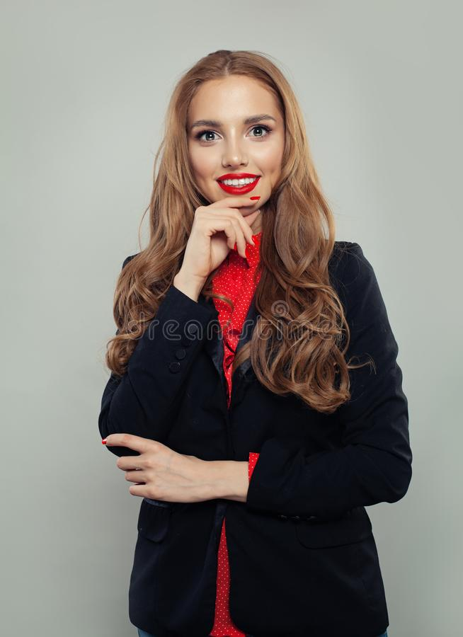 Business woman or student in black suit portrait. Young model on white background.  royalty free stock photo