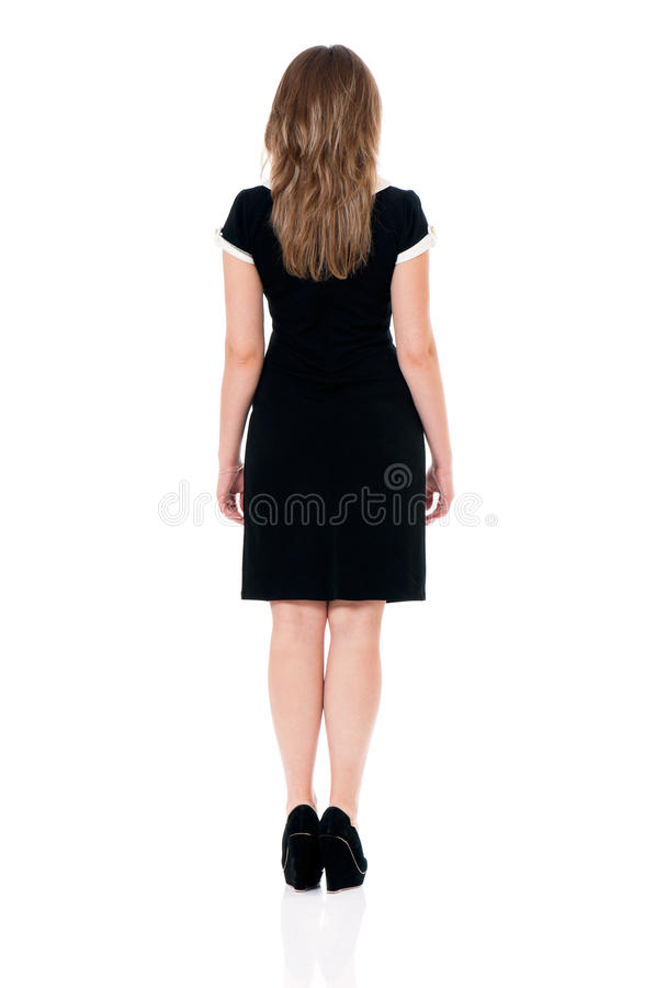 Business woman. Successful business woman in black dress - back view, isolated white background royalty free stock photo