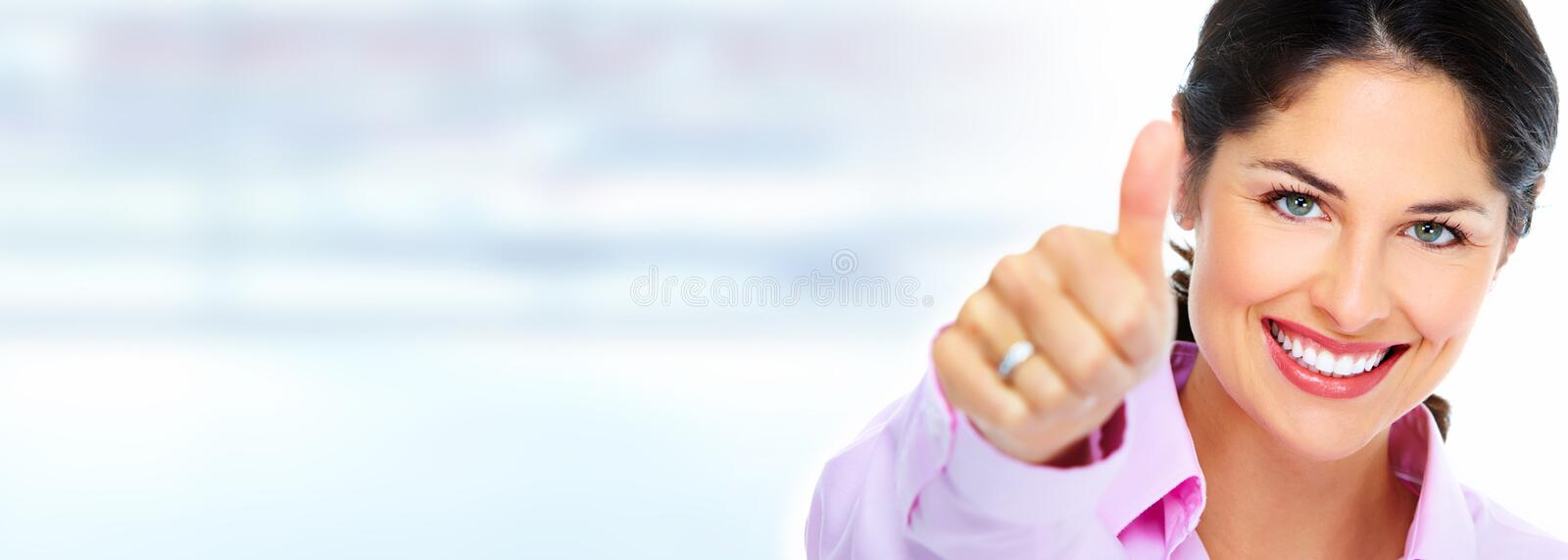 Business woman. Successful business woman over abstract office background stock photo