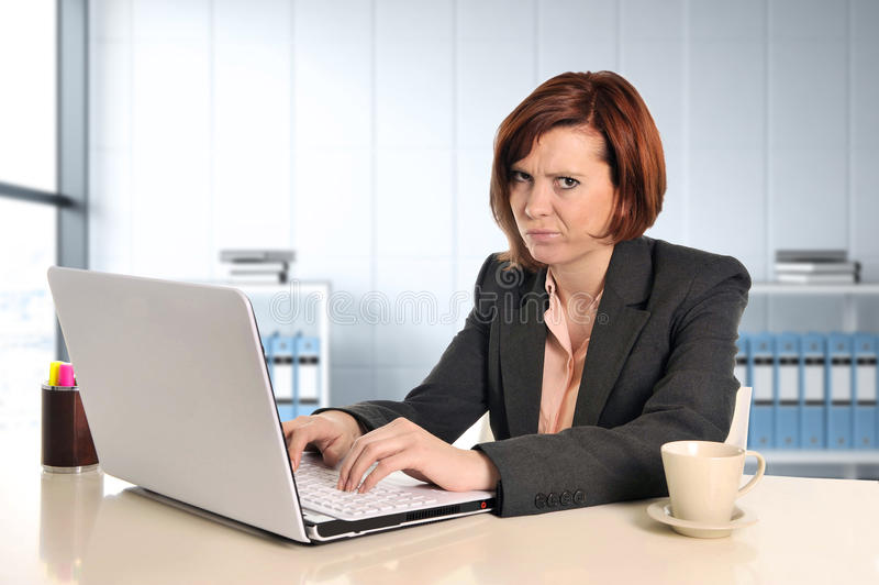 Business woman suffering stress working at office computer desk worried stock photo