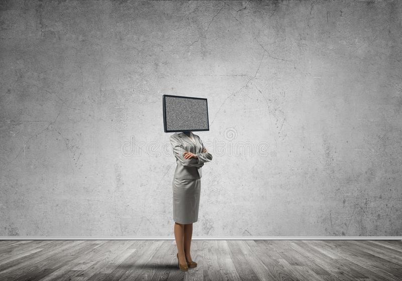 Business woman with TV instead of head. stock photo