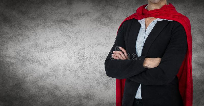 Business woman superhero mid section with arms folded against grey background and grunge overlay royalty free stock photography