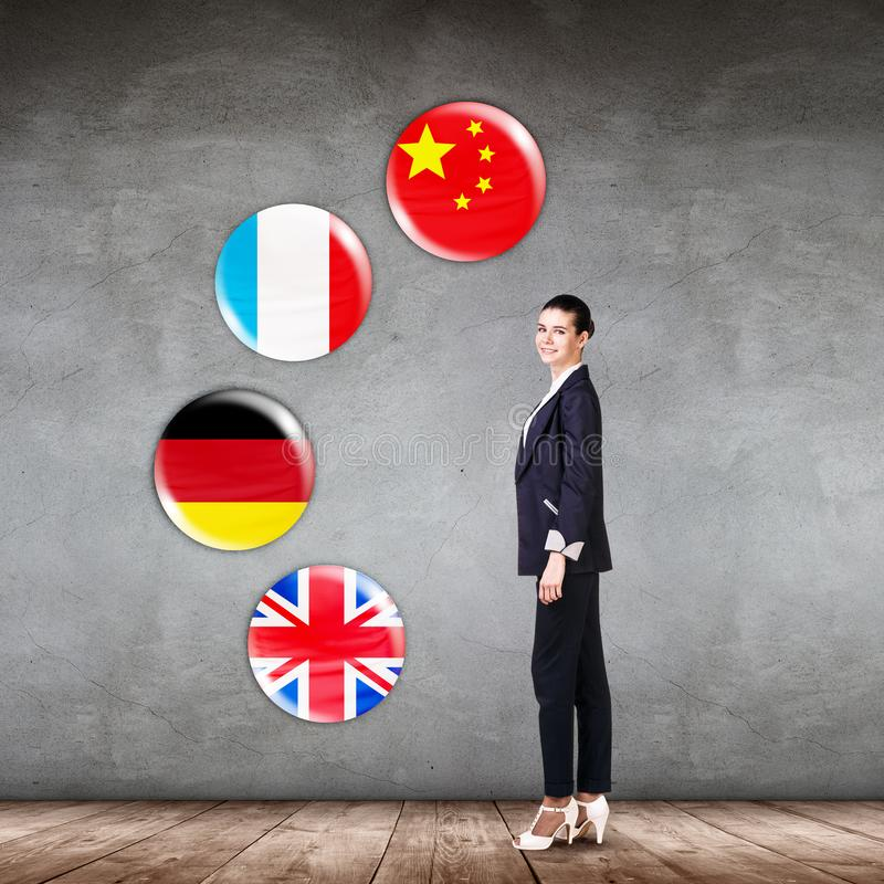 Business woman surrounded by dialogue bubbles with countries flags. royalty free stock photo