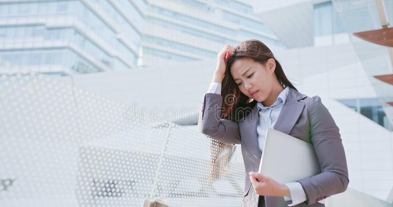 Business woman feel confuse. Business woman take computer and feel confuse stock photos