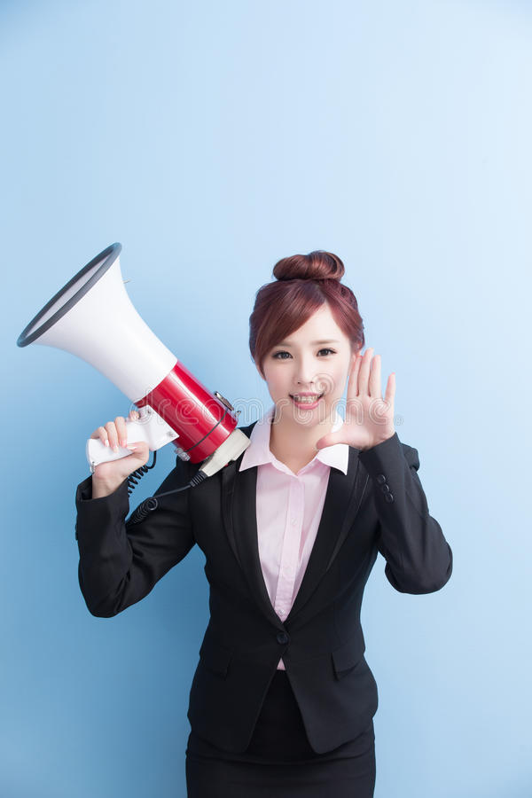 Business woman take microphone happily. With isolated on blue background stock photos