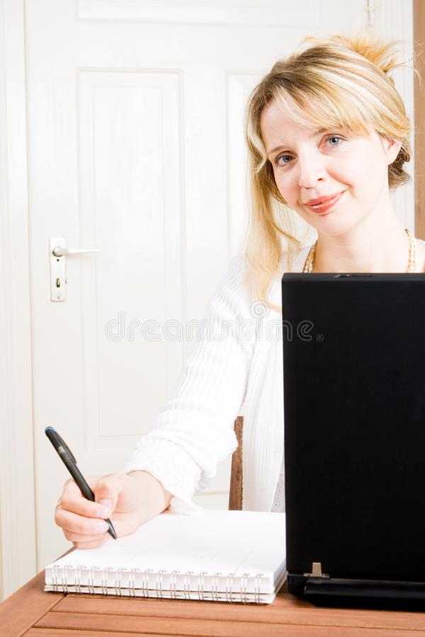 A Business Woman Taking Notes Free Stock Photo