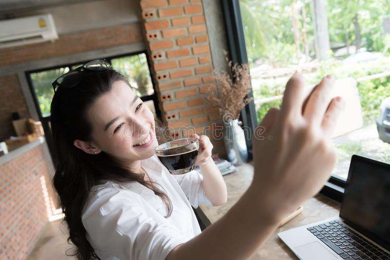 Business woman taking selfie on the phone in coffee break time at her work place. Business woman taking selfie on the phone in coffee break time at work place stock photos