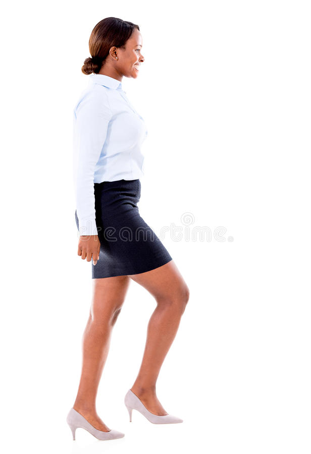 Business woman taking a step forward