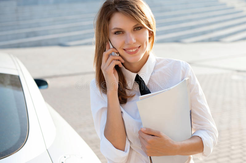 Business woman talking on her mobile phone. City business woman working. royalty free stock photo