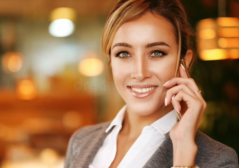 Business woman talking on the mobile phone royalty free stock images