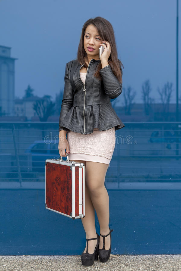 Business woman talking on mobile smart phone stock photos