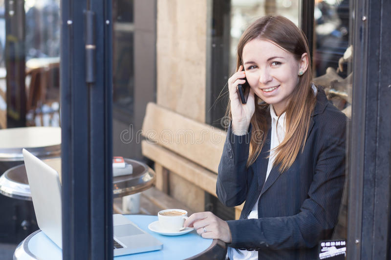 Business woman talking by phone stock photography