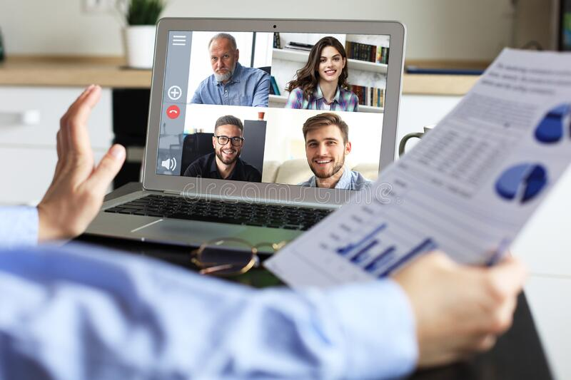 Business woman talking to her colleagues in video conference. Business team working from home using laptop. Business women talking to her colleagues in video stock photography