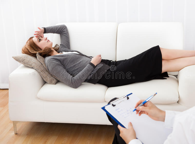 Business woman talking to his psychiatrist explaining something stock image