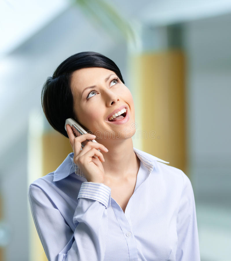 Business woman talks on cellphone stock photography