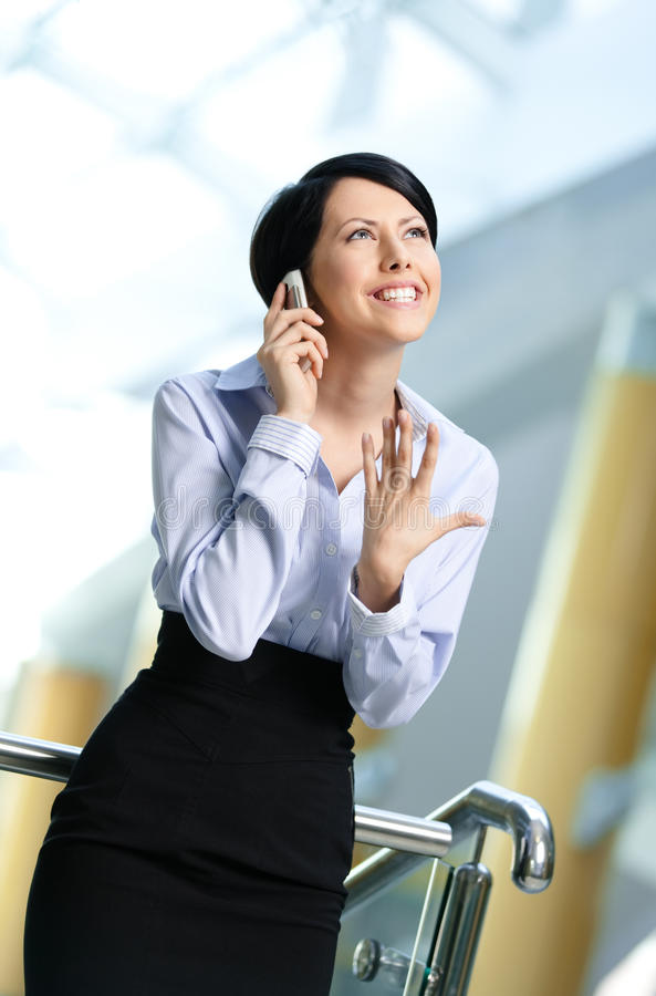 Business woman talks on cellular phone stock images