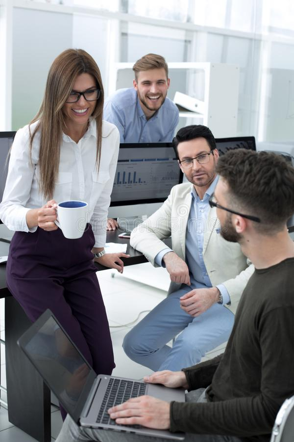 Business woman and business team talking during work break stock photography