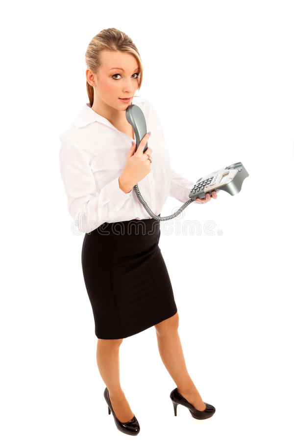 Business woman on Telephone. Business woman in black skirt and white blouse holding a telephone stock images