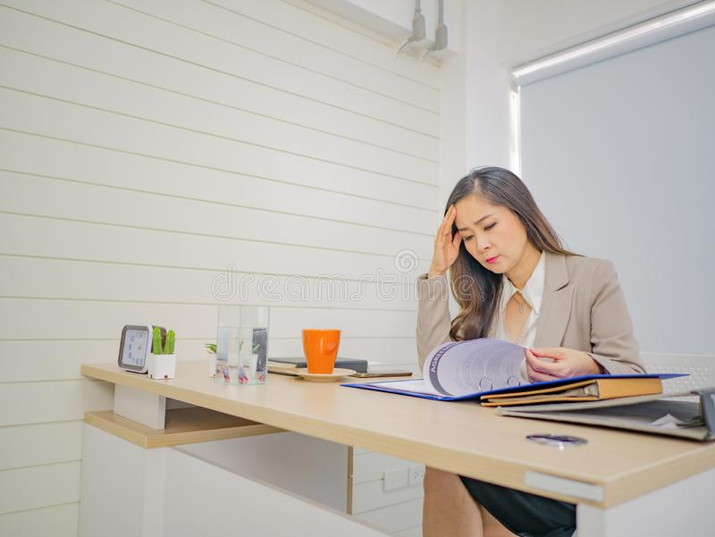 Business women thing about something very serious in her office stock image
