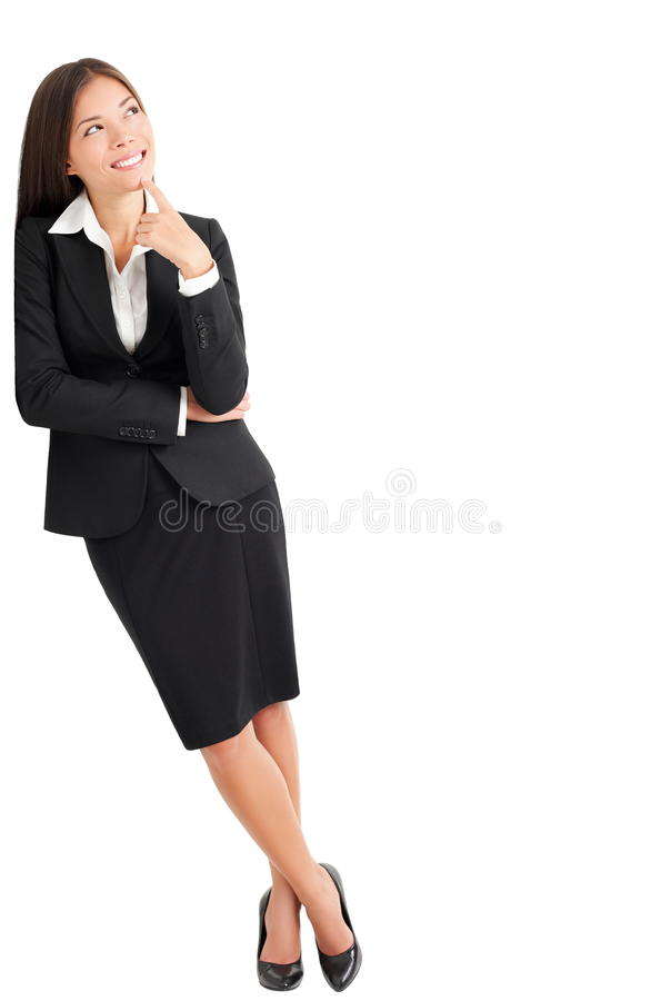 Business woman thinking leaning. Businesswoman thinking leaning on wall looking up at copy space. Young mixed race Caucasian Asian professional woman isolated on royalty free stock photos