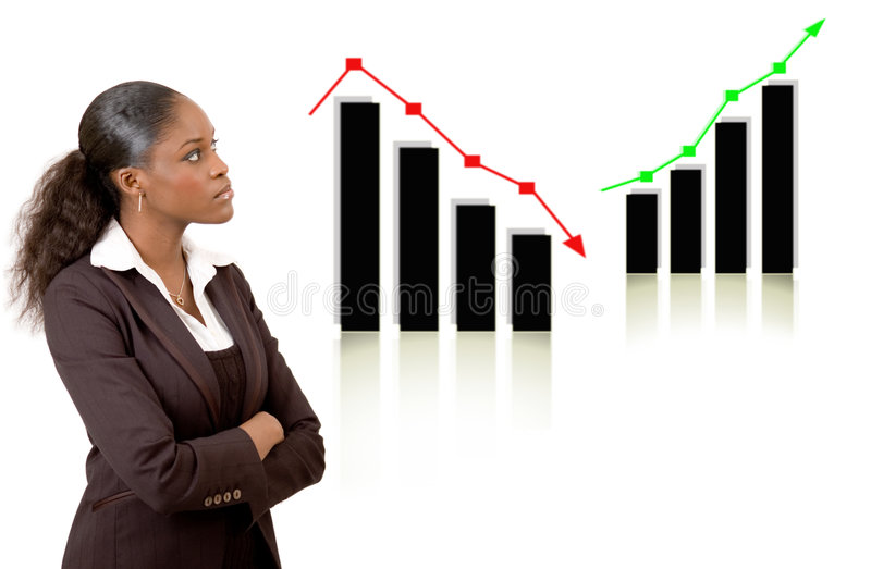 Business woman thinking with rise and fall graphs stock photo
