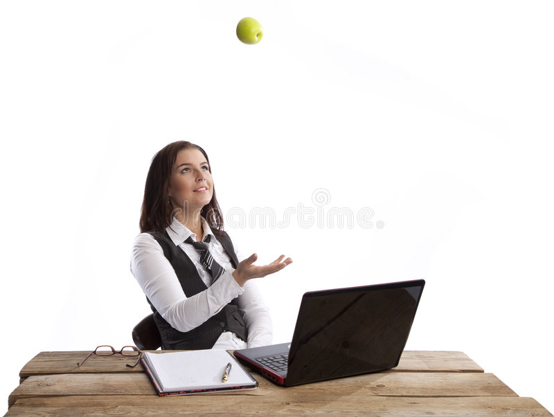Business woman throwing apple. Isolated business woman throwing green apple over white background royalty free stock photo