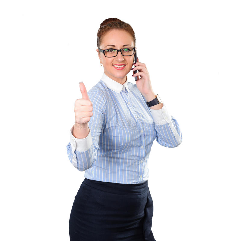 Business woman with thumbs up gesture and cell phone. Young stylish business woman isolated on white. White caucasian redhead female model stock photos