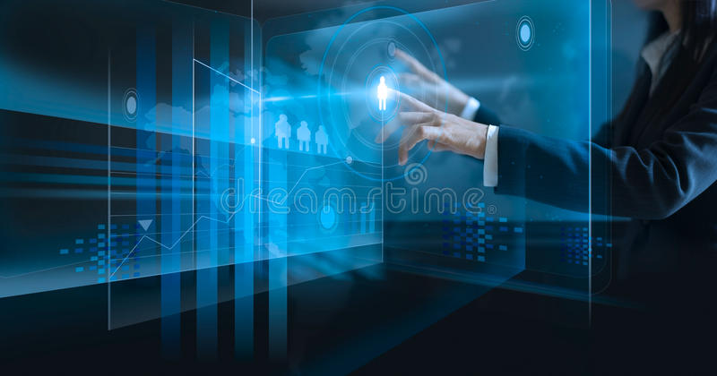 Business woman touching virtual screen, pushing icon on media at dark stock photo