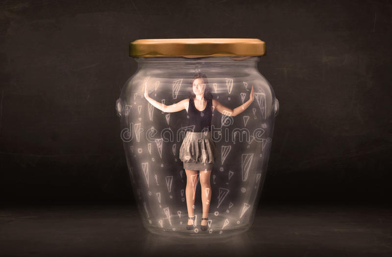 Business woman trapped in jar with exclamation marks concept royalty free stock photography