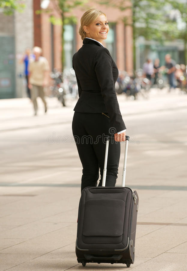 Download Business Woman Traveling With Suitcase In The City Stock Image - Image: 32648707