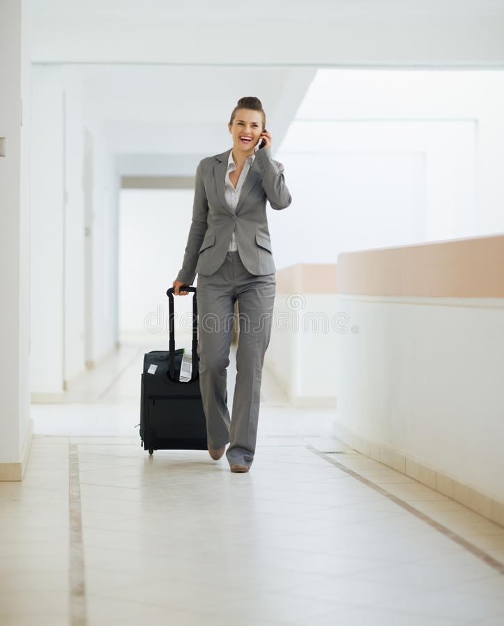 Download Business Woman In Trip Walking With Wheel Bag Stock Image - Image of cellphone, entrepreneur: 26999785